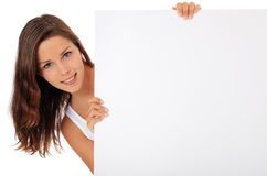 Teenage girl behind blank white sign Stock Images