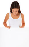 Teenage girl behind blank white signboard Royalty Free Stock Image