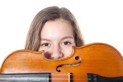 Teenage girl behind violin Royalty Free Stock Photography