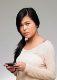 Teenage Girl Being Bullied By Text Message On Mobile Phone. Looking Upset stock photography
