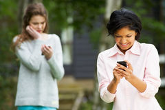 Teenage Girl Being Bullied By Text Message On Mobile Phone Royalty Free Stock Photography