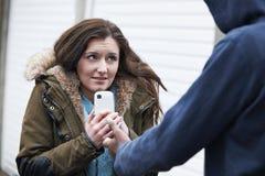 Teenage Girl Being Mugged For Mobile Phone Stock Image