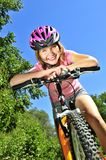 Teenage girl on a bicycle. Portrait of a teenage girl on a bicycle in summer park outdoors stock photo