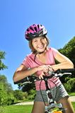 Teenage girl on a bicycle Stock Image