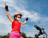 Teenage girl on a bicycle Stock Images