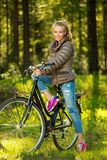 Teenage girl on a bicycle outdoors Royalty Free Stock Photography