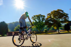 Teenage girl bicycling in roller boots. Speed shooting. Teenage girl bicycling in roller boots. Quickly moving Royalty Free Stock Photo
