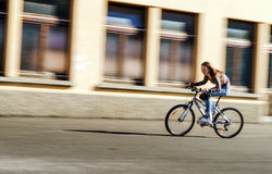 Teenage girl bicycling in roller boots. Speed shooting. Teenage girl bicycling in roller boots. Quickly moving Royalty Free Stock Photos