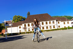 Teenage girl bicycling in roller boots. Speed shooting. Teenage girl bicycling in roller boots. Quickly moving Stock Photography