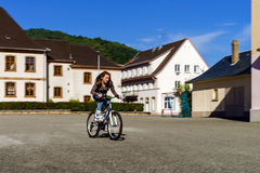 Teenage girl bicycling in roller boots. Speed shooting. Teenage girl bicycling in roller boots. Quickly moving Stock Photo