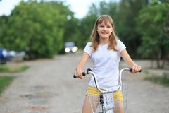 Teenage girl with a bike-riding. A teenage girl with a bike-riding in the street stock photos