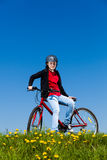 Teenage girl biking Stock Photography