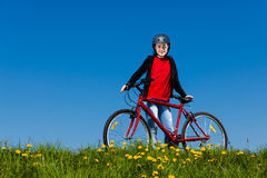 Teenage girl biking Stock Photo