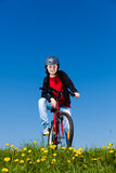 Teenage girl biking Royalty Free Stock Photo