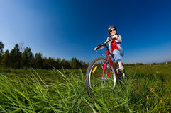 Teenage girl biking Stock Images