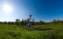 Teenage girl biking Royalty Free Stock Photo