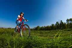 Teenage girl biking Royalty Free Stock Image