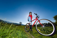 Teenage girl biking Royalty Free Stock Images