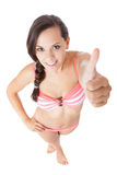 Teenage girl in bikini showing thumbs up Royalty Free Stock Photos
