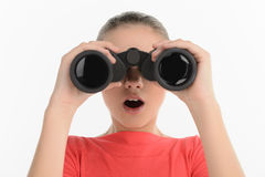 Teenage girl with binoculars. Excited teenage looking through bi Stock Images