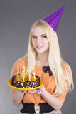 Teenage girl with birthday cake Royalty Free Stock Image