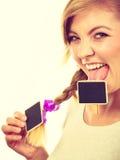 Teenage girl biting little school blackboards Stock Image