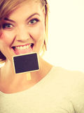 Teenage girl biting little school blackboards Royalty Free Stock Image
