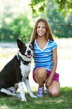 Teenage girl and black dog Stock Images