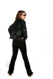 Teenage girl in black jeans and leather jacket Stock Image