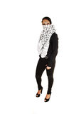 Girl with scarf. A teenage girl in black tights and jacket with a scarf covering her mouth Royalty Free Stock Images