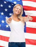 Teenage girl in blank white t-shirt with thumbs up Stock Image