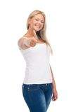 Teenage girl in blank white t-shirt with thumbs up Royalty Free Stock Images