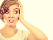 Teenage girl in blonde hair making shocked face Royalty Free Stock Images