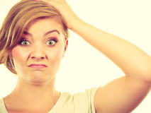Teenage girl in blonde hair making shocked face. Emotions expressions, fooling around concept. Astonished teenage girl in blonde hair making funny, shocked face Stock Photos