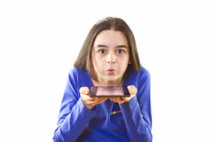 Teenage girl blowing app icons from digital tablet Royalty Free Stock Images