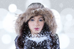 Teenage girl blowing snow Royalty Free Stock Image