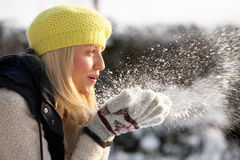 Teenage Girl Blowing snow out of hands Stock Photos