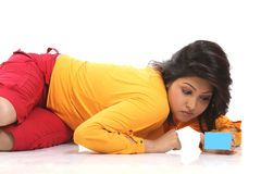 Teenage girl  with blue credit. Beautiful Teenage  girl lying on floor with blue credit card Royalty Free Stock Images