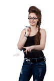 Teenage girl in a blue denim dress Stock Images