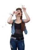 Teenage girl in a blue denim dress Royalty Free Stock Photo