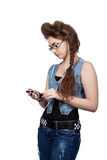 Teenage girl in a blue denim dress Royalty Free Stock Photos