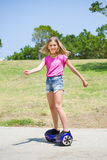 Teenage girl on blue hoverboard Royalty Free Stock Images