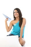 Teenage girl with blue paper plane Royalty Free Stock Photo