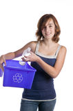 Teenage girl with a blue recycling basket Royalty Free Stock Images