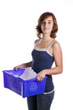 Teenage girl with a blue recycling basket Stock Image