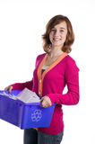 Teenage girl with a blue recycling basket Royalty Free Stock Image