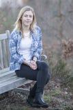 Teenage girl with blue shirt Stock Photos