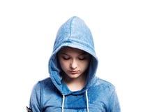 Teenage girl in blue sweatshirt. Studio shot, isolated. Stock Photo