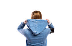 Teenage girl in blue sweatshirt. Studio shot, isolated. Royalty Free Stock Photos