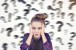 Teenage girl and blurred question marks Royalty Free Stock Image